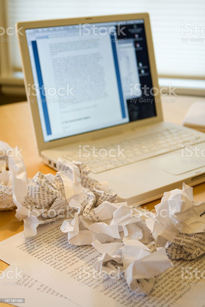 Writer's Block, Frustration in Writing with Laptop and Crumpled Paper royalty-free stock photo