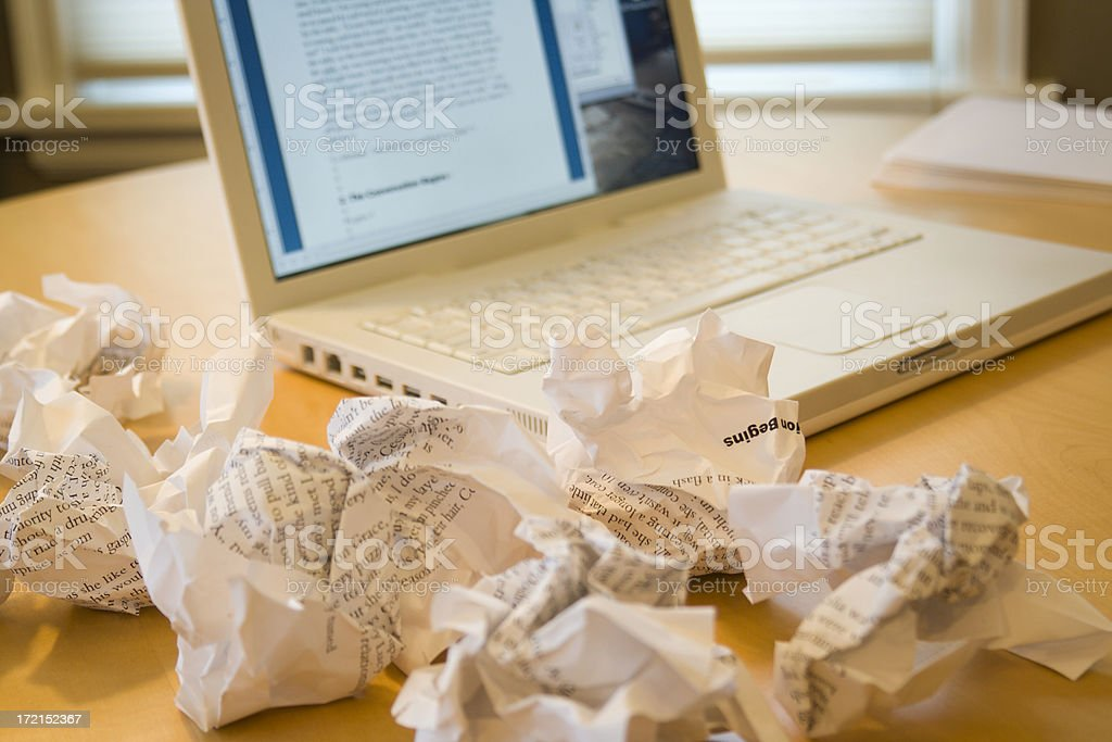 Writer's Block or Writing Frustration via Laptop Computer, Crumpled Paper stock photo