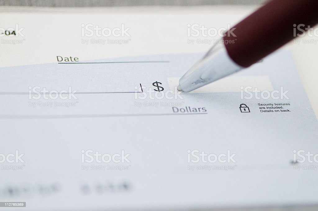 Writing a check. stock photo
