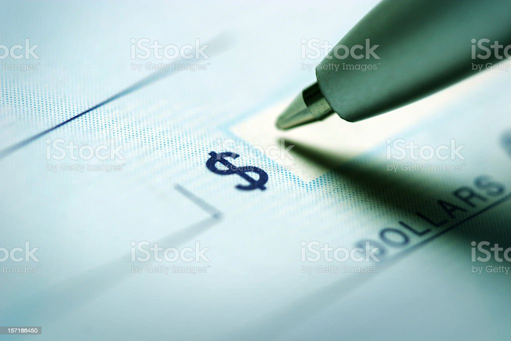 Writing A Check stock photo