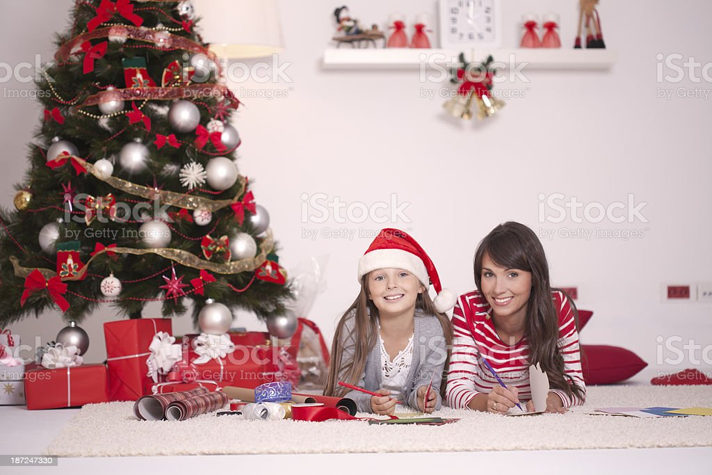 Writing a Christmas greeting cards. royalty-free stock photo
