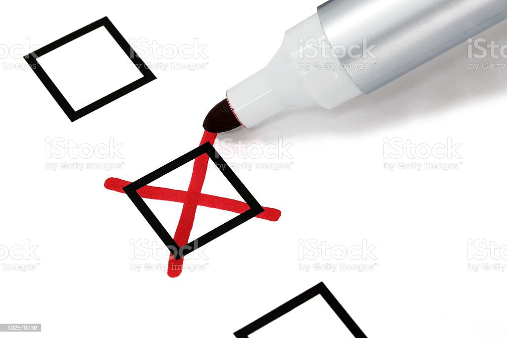 Writing a cross on checkbox stock photo