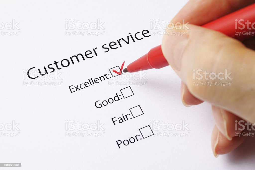 Writing a customer service feedback form with red check mark royalty-free stock photo