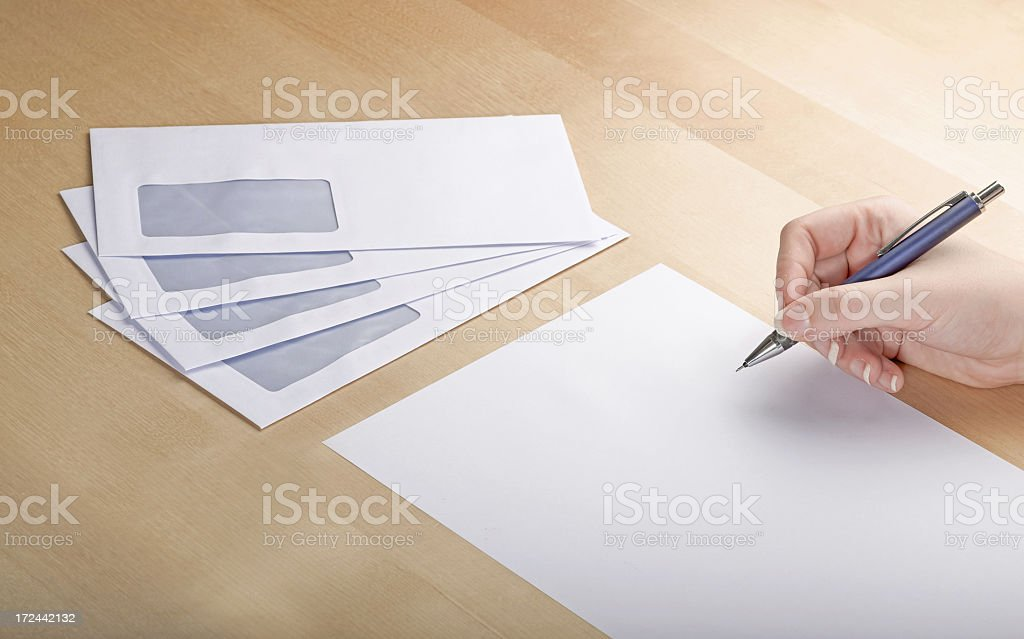 Writing a letter on wooden table stock photo