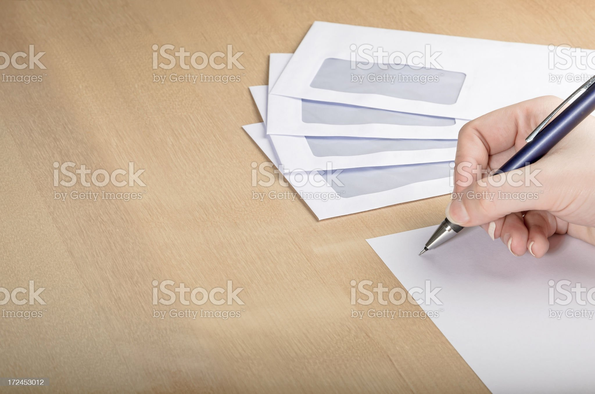 Writing a letter on wooden table royalty-free stock photo
