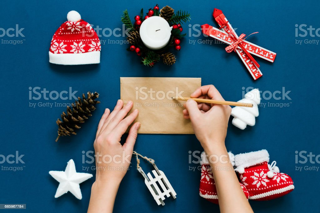Writing a letter to Santa on the themes background stock photo