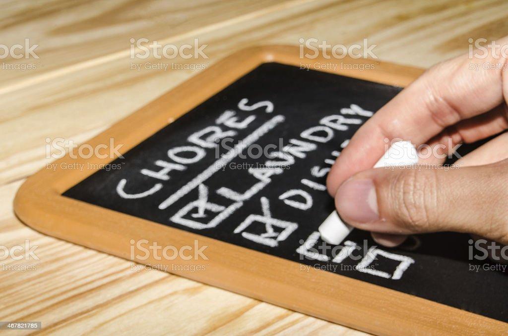 Writing a list on a Blackboard stock photo