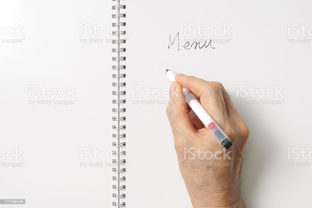 Writing a menu on spiral notebook like a whiteboard royalty-free stock photo