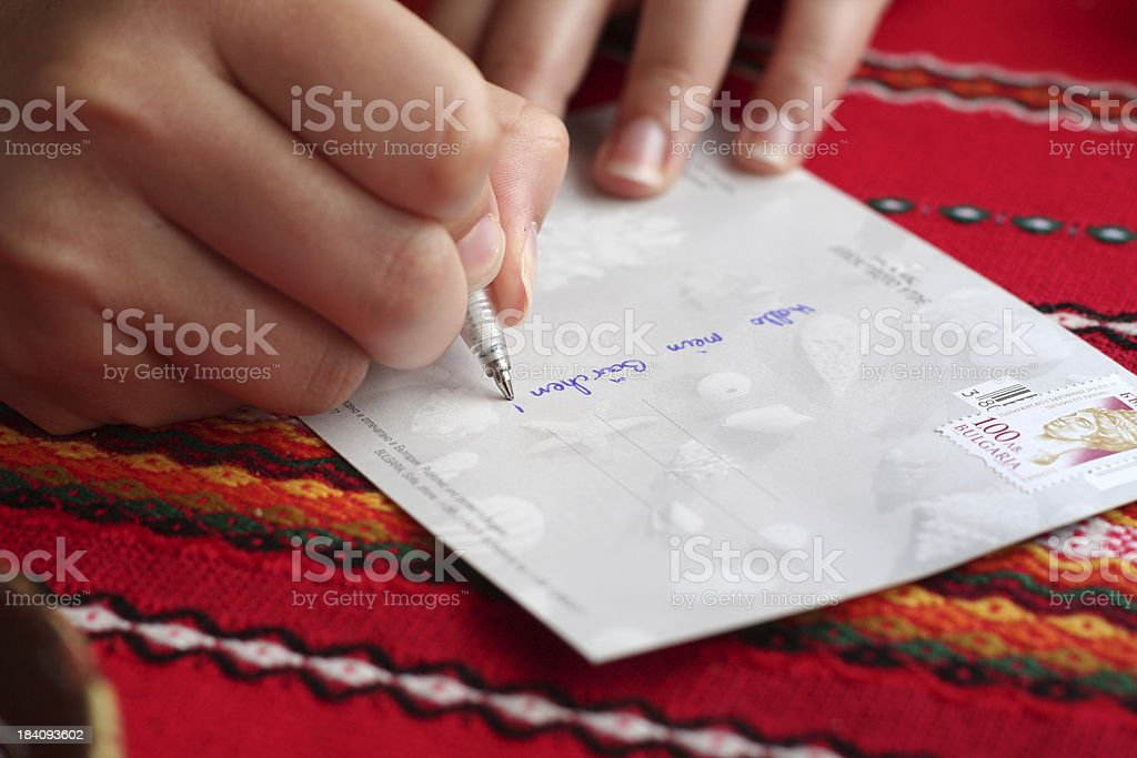 Writing a postcard royalty-free stock photo