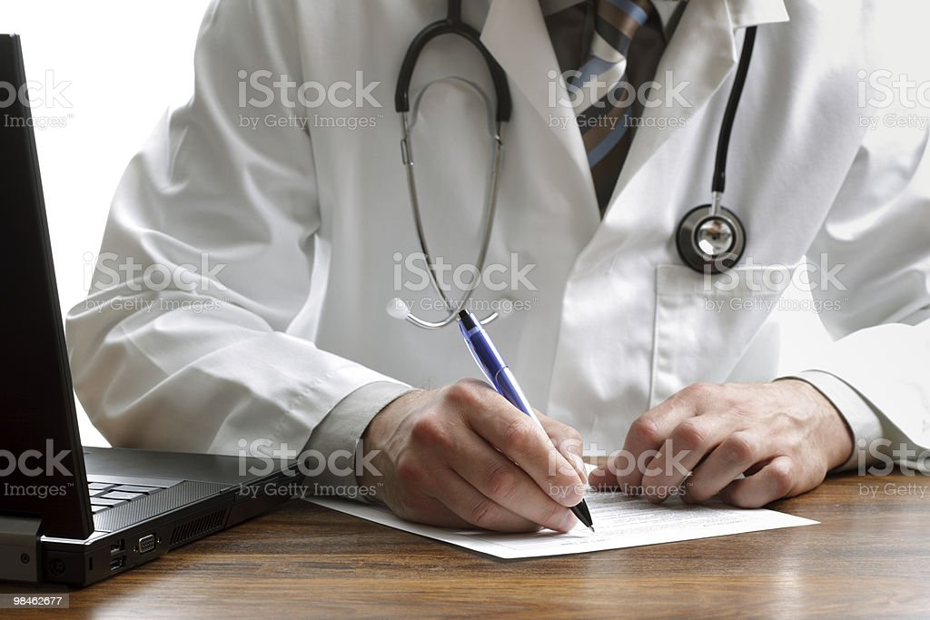 Writing a prescription or medical examination notes royalty-free stock photo