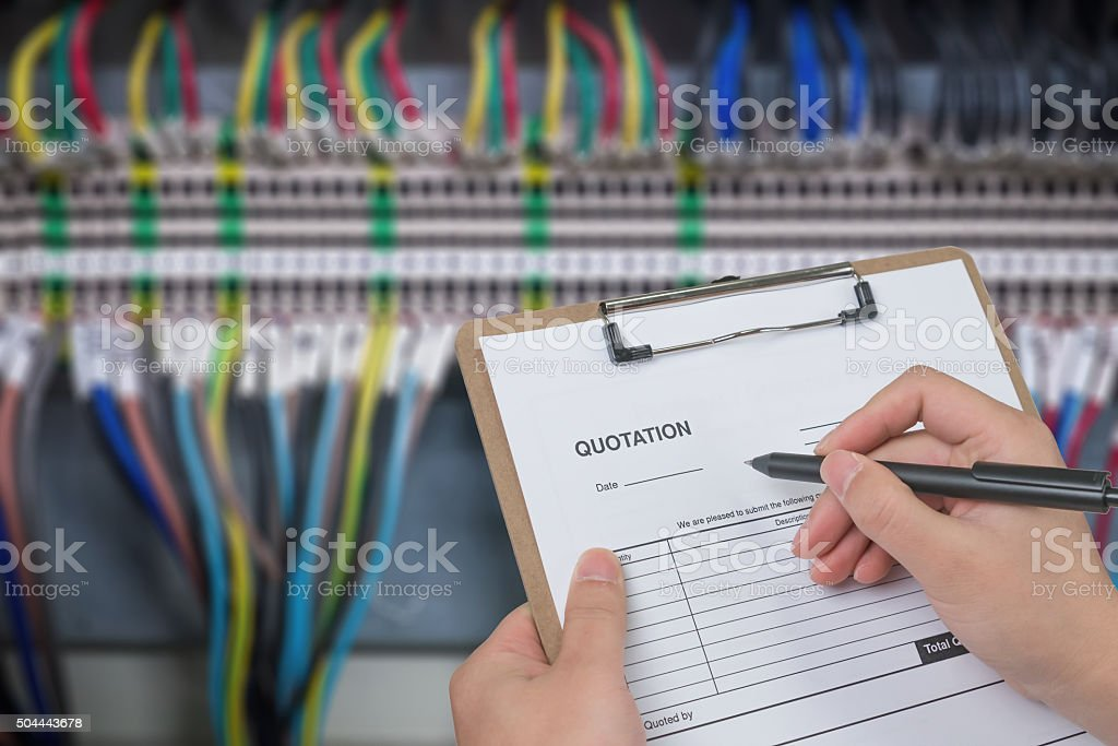 Writing a quote for industrial electrical control panel stock photo