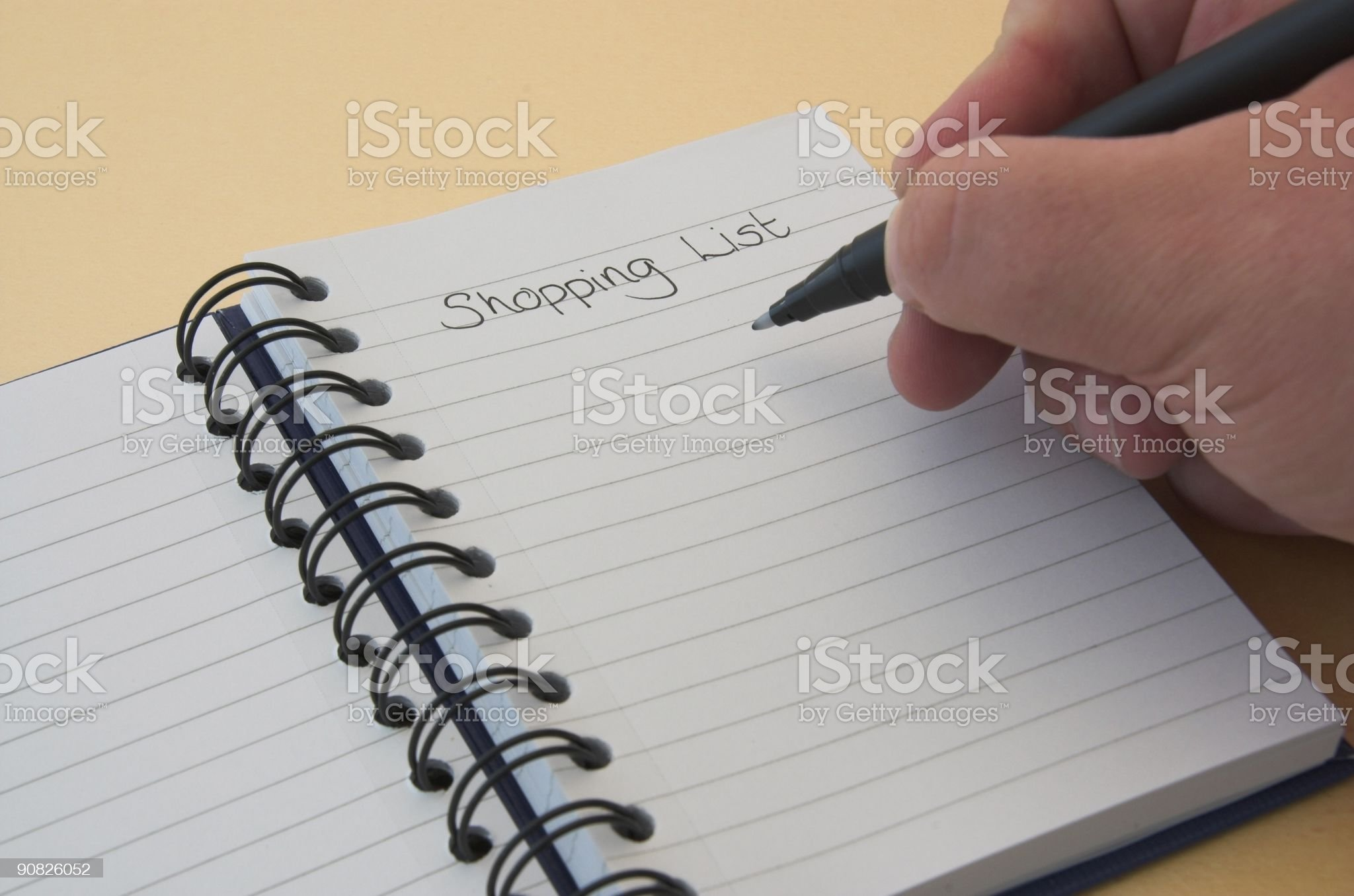 Writing a shopping list royalty-free stock photo