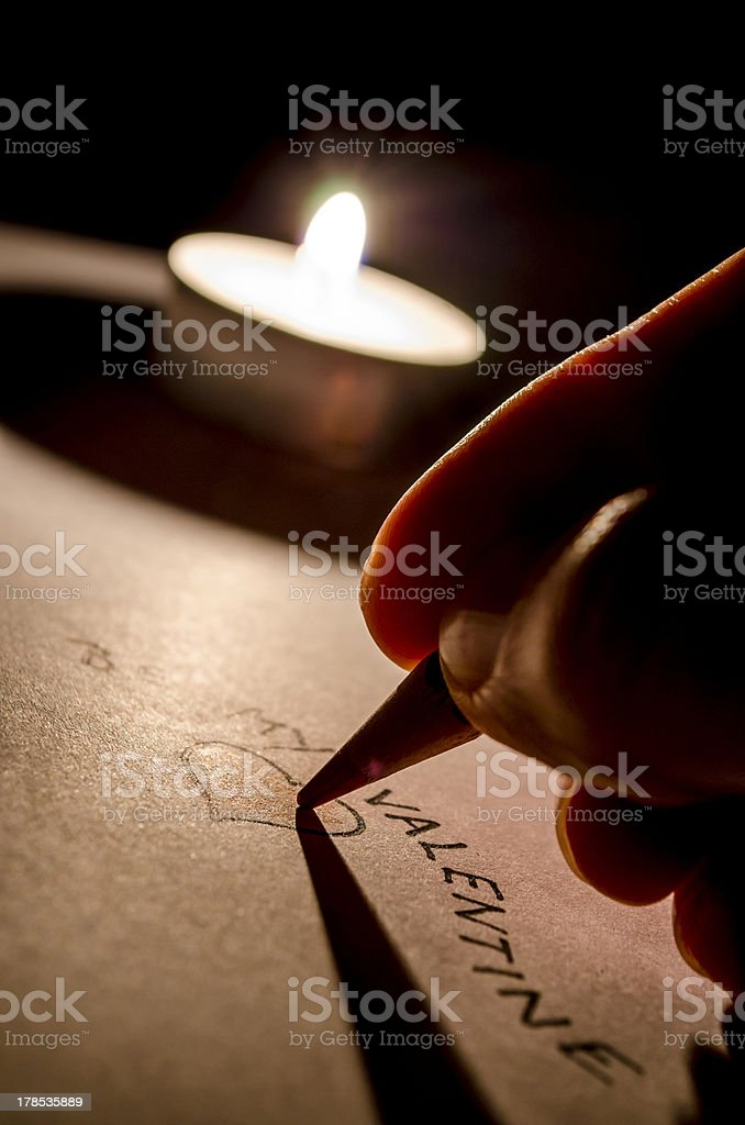 Writing a valentine message royalty-free stock photo