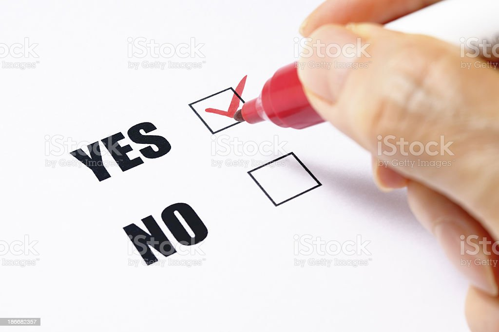 Writing a YES or NO check box on white background royalty-free stock photo
