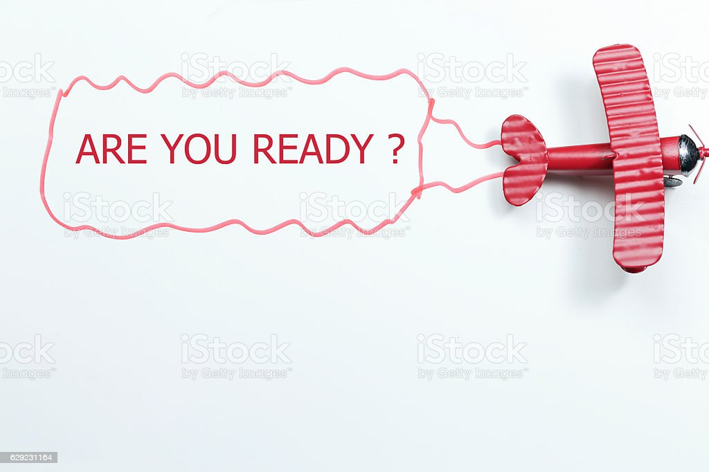 writing are you ready red toy airplane with talk bubble stock photo