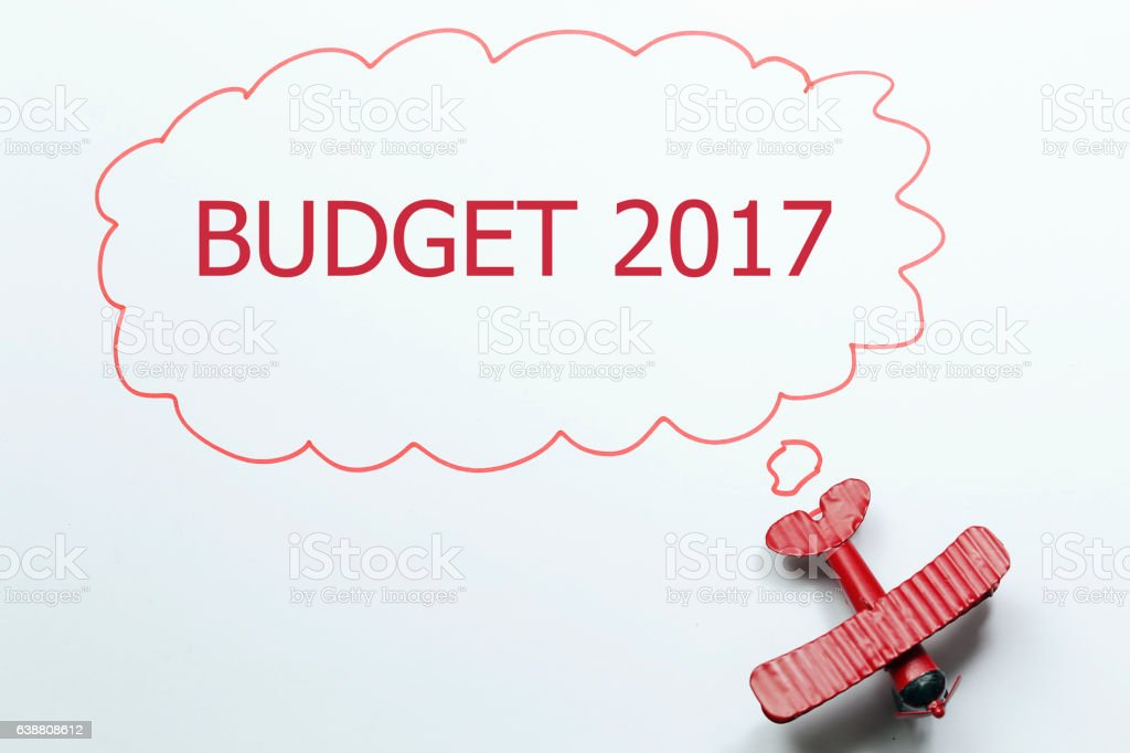 writing budget 2017 red toy airplane with talk bubble stock photo