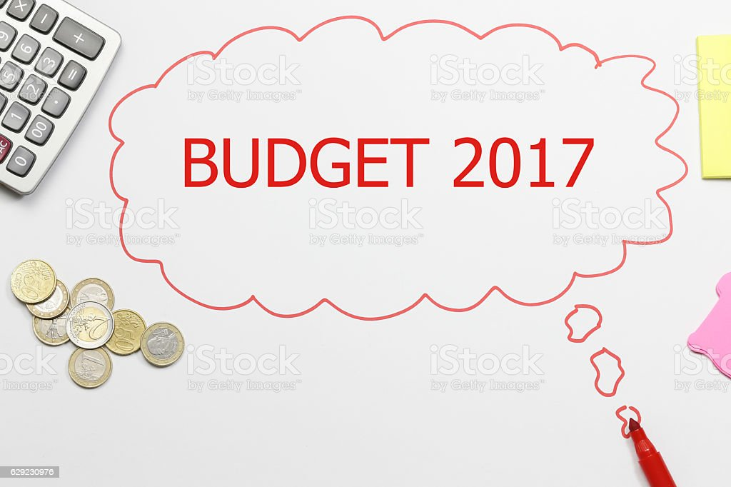 writing budget 2017 with pencil, coins, calculator, sticky note stock photo