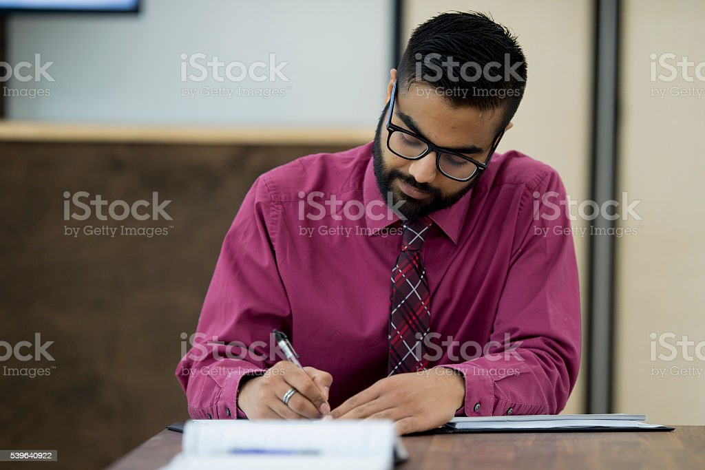 Writing Checks at the Office stock photo
