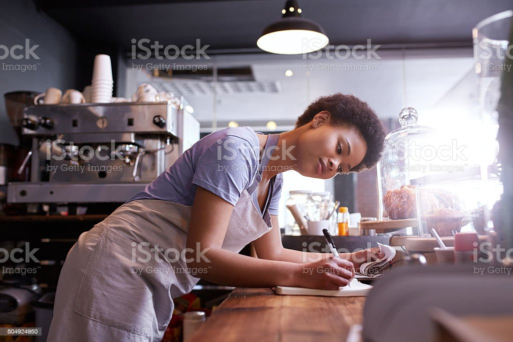 Writing down every single order stock photo