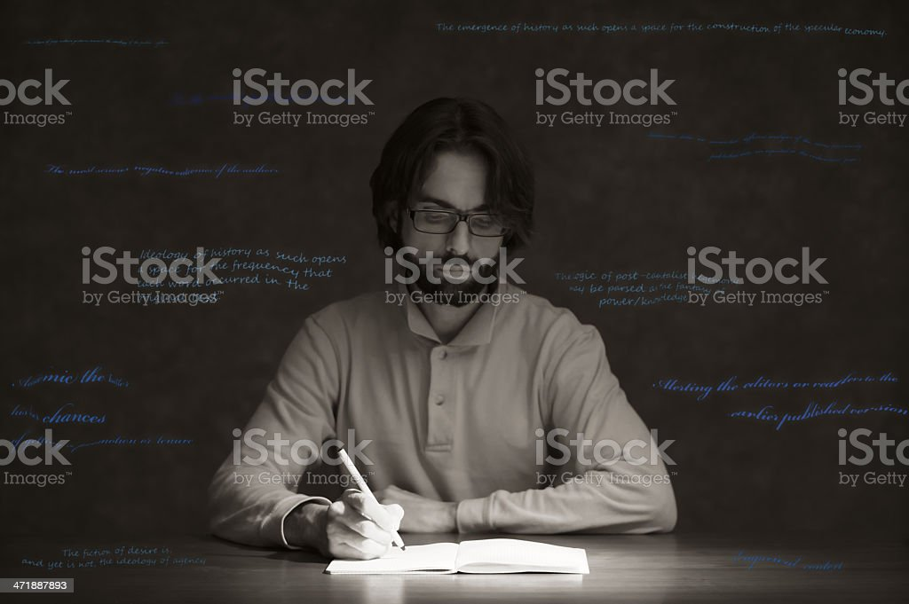 Writing down ideas on a notebook royalty-free stock photo