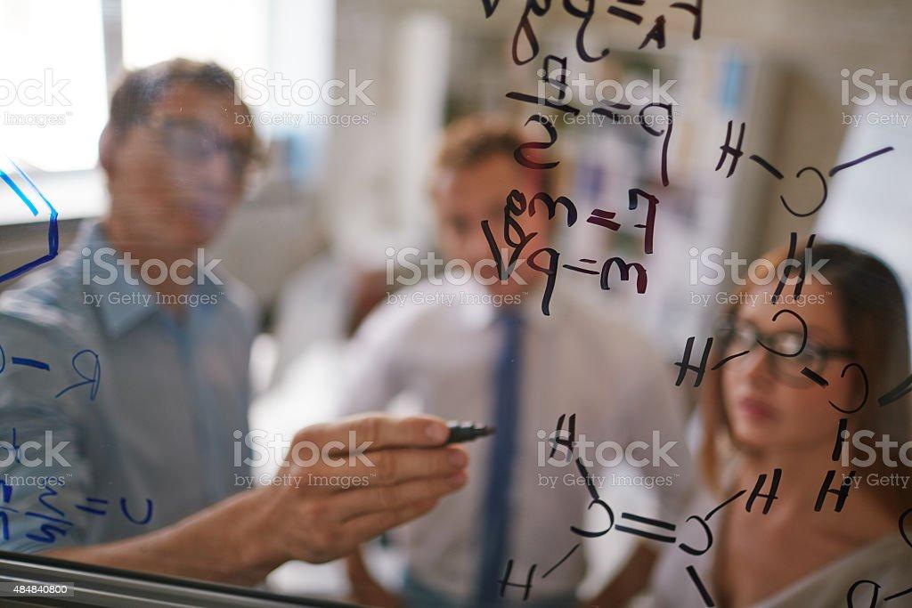 Writing formulae stock photo