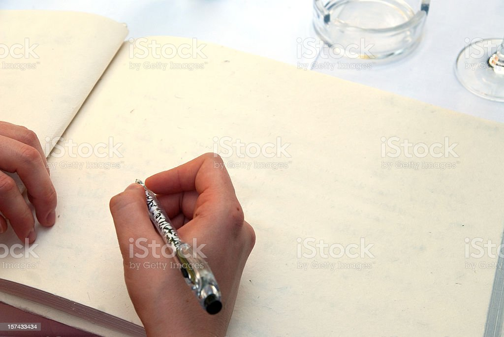writing in a book stock photo