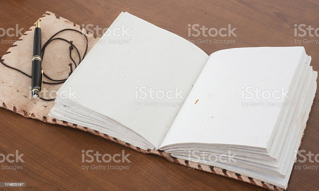 writing in a leatherbook ampty sites with copyspace stock photo