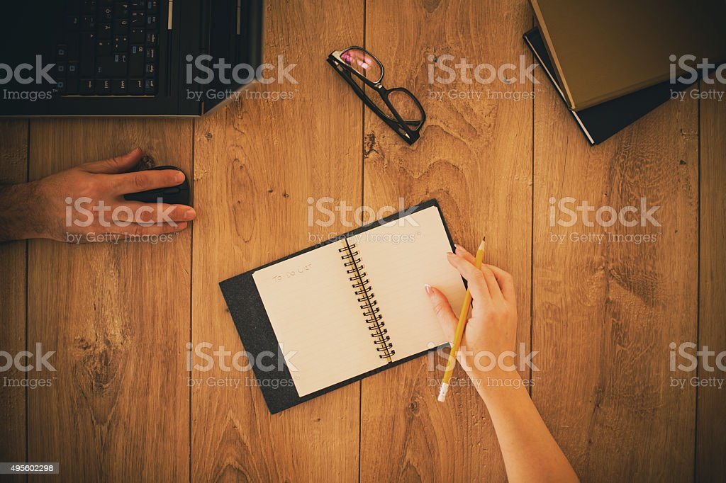 Writing in a notebook during meeting stock photo