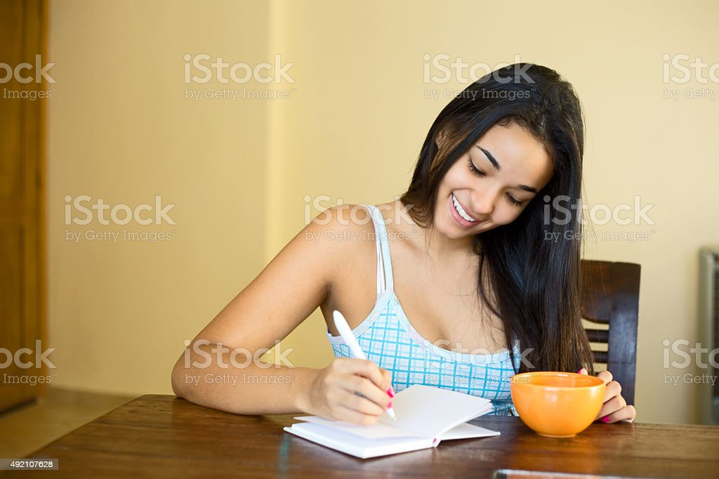 writing in a notebook royalty-free stock photo