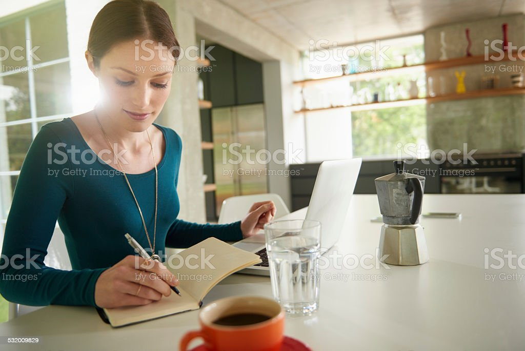 Writing in her diary stock photo
