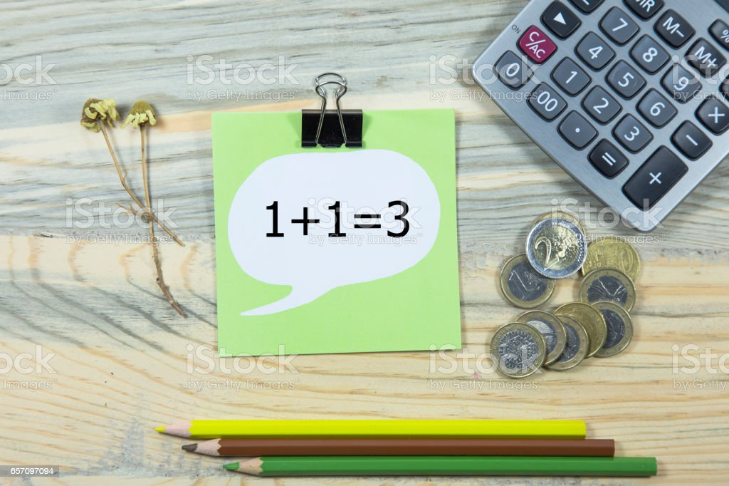 1+1=3 writing in notebook pen and calculator stock photo