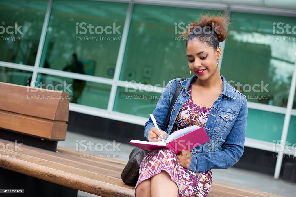 writing in notebook royalty-free stock photo