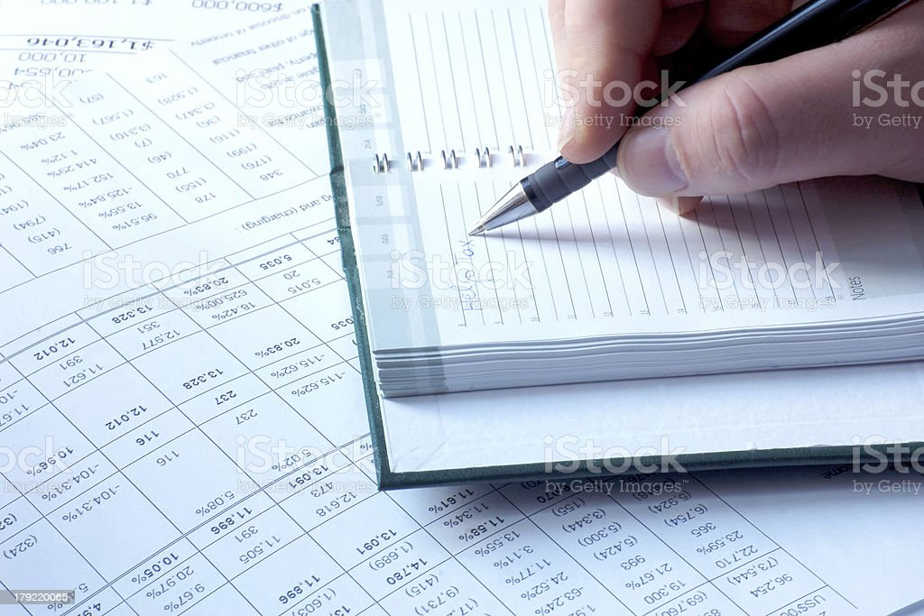 writing in notebook tax help royalty-free stock photo