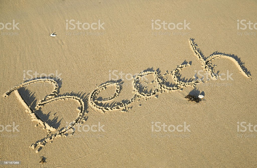 Writing in the sand of a beach royalty-free stock photo