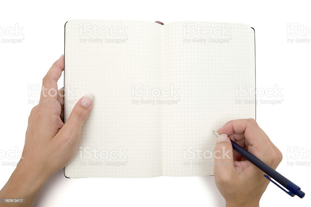 Writing Into a Checkered Notebook stock photo