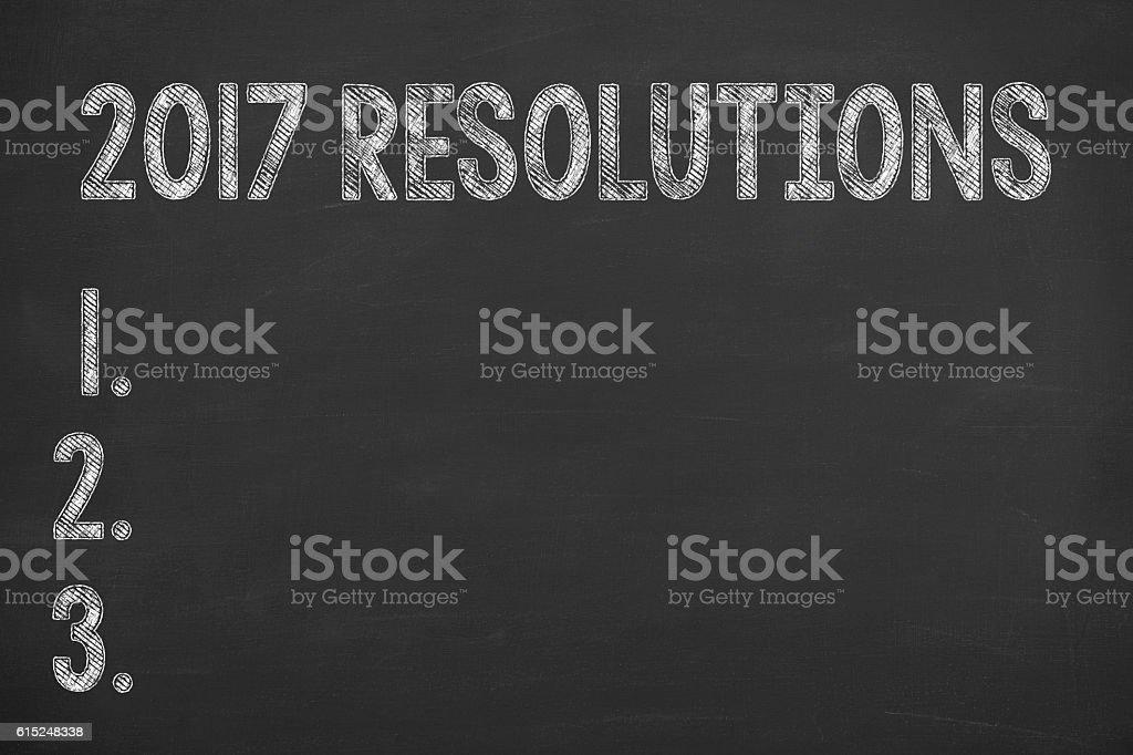 Writing New Year 2017 Resolution on Blackboard stock photo