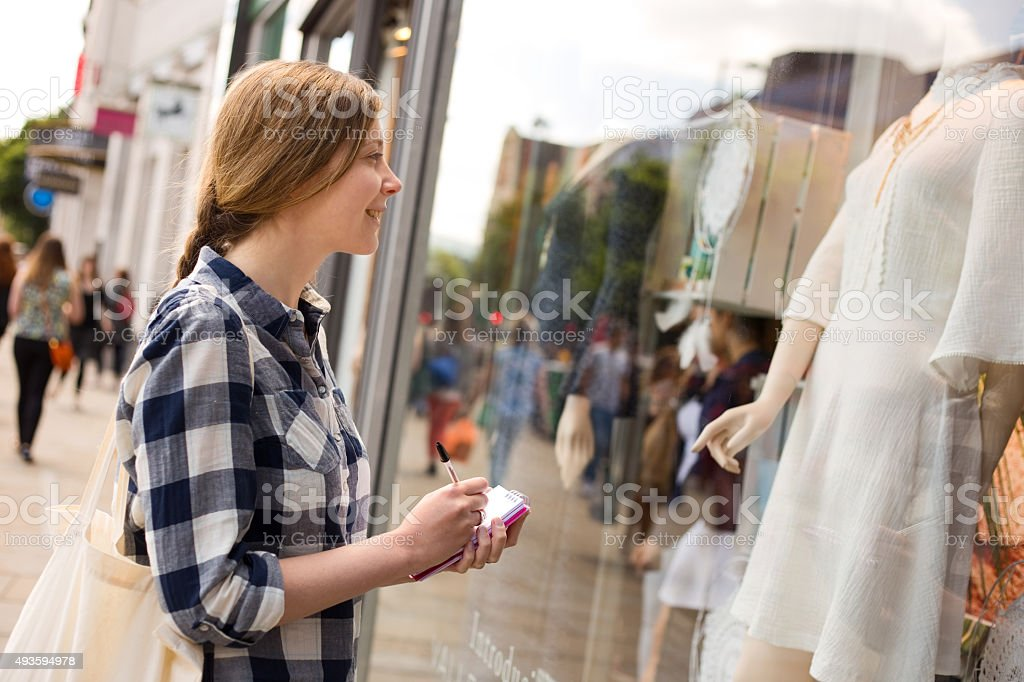 writing notes at a shop window stock photo