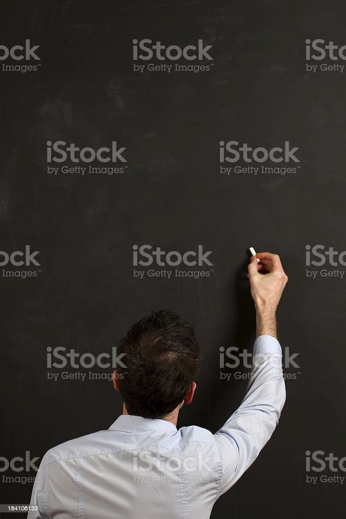 Writing on a blackboard royalty-free stock photo
