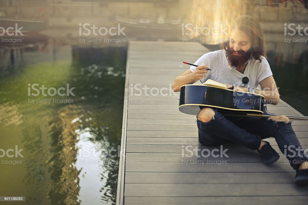 Writing on a guitar stock photo