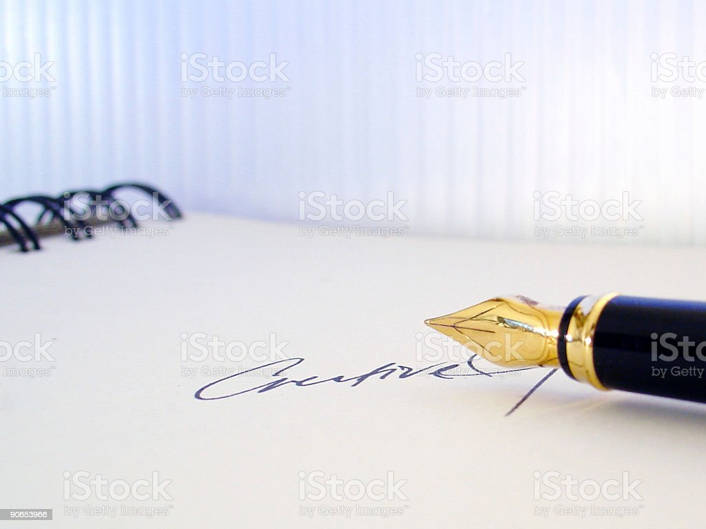 writing on a note pad royalty-free stock photo