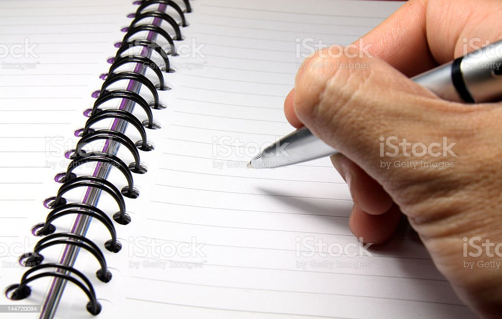 Writing On A Notebook royalty-free stock photo