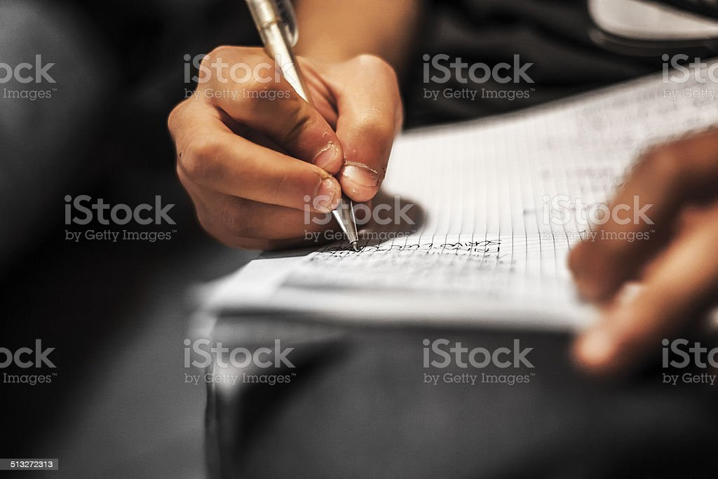 Writing on a paperwork stock photo
