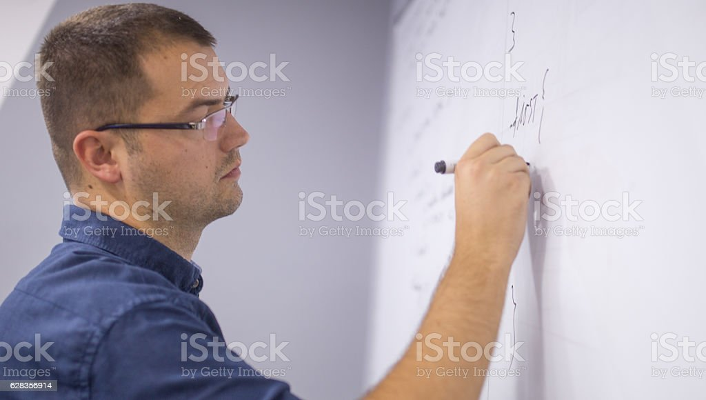 Writing on a white board stock photo