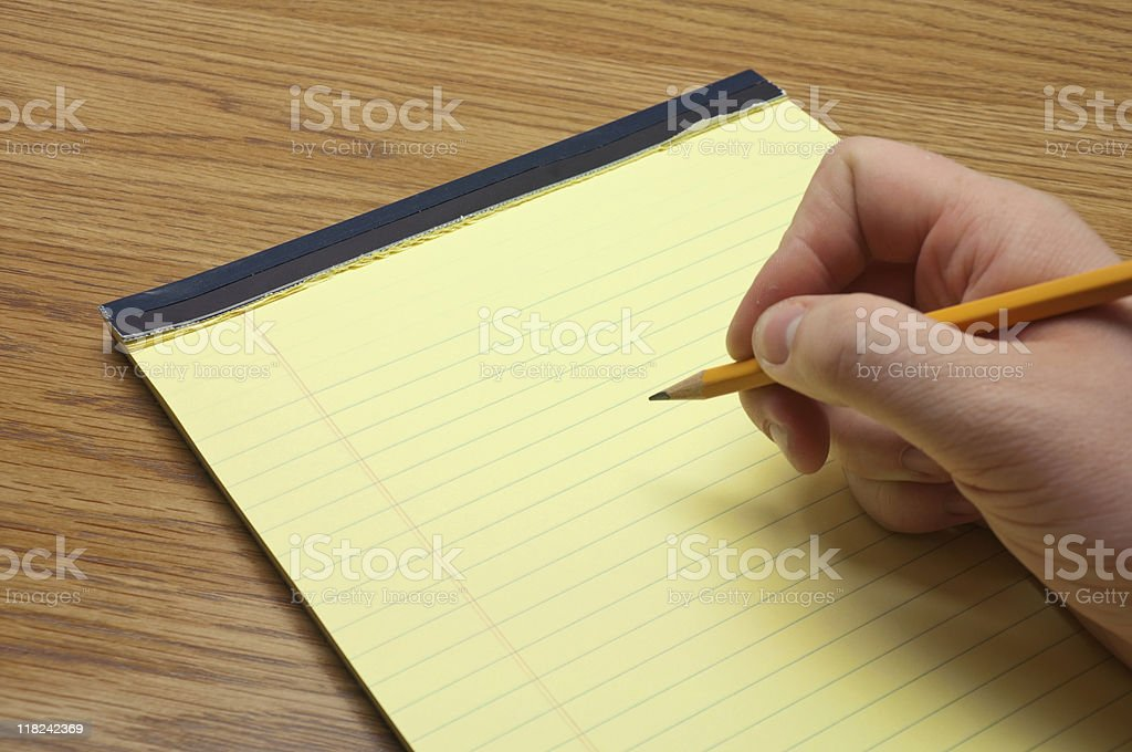 Writing on a Yellow Message Pad royalty-free stock photo