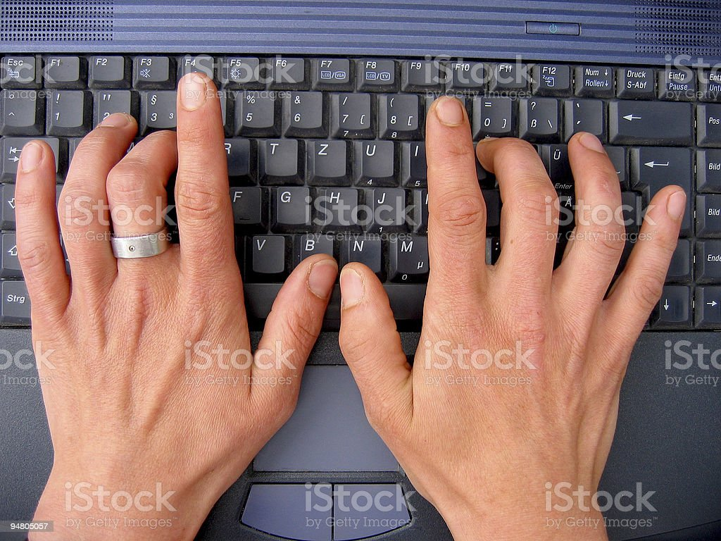 writing on laptop royalty-free stock photo