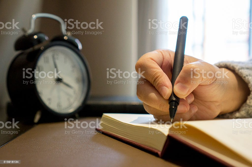 writing on notebook stock photo