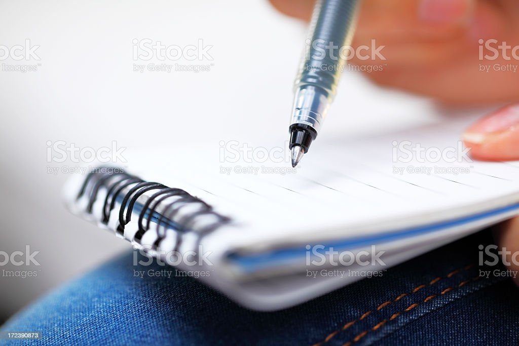writing on notepad close up royalty-free stock photo