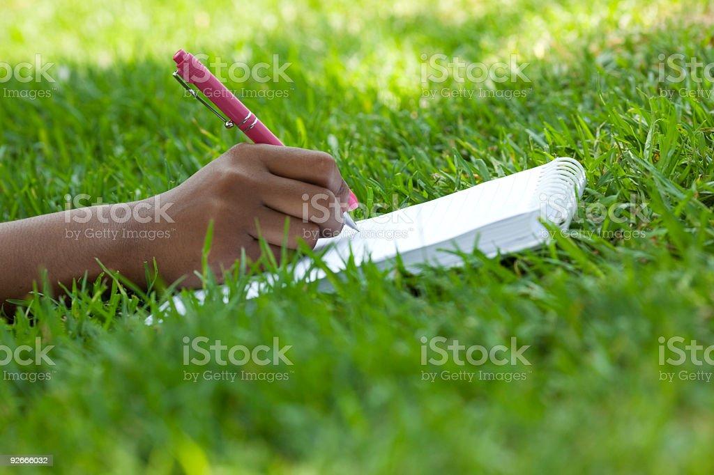 Writing on notepad stock photo