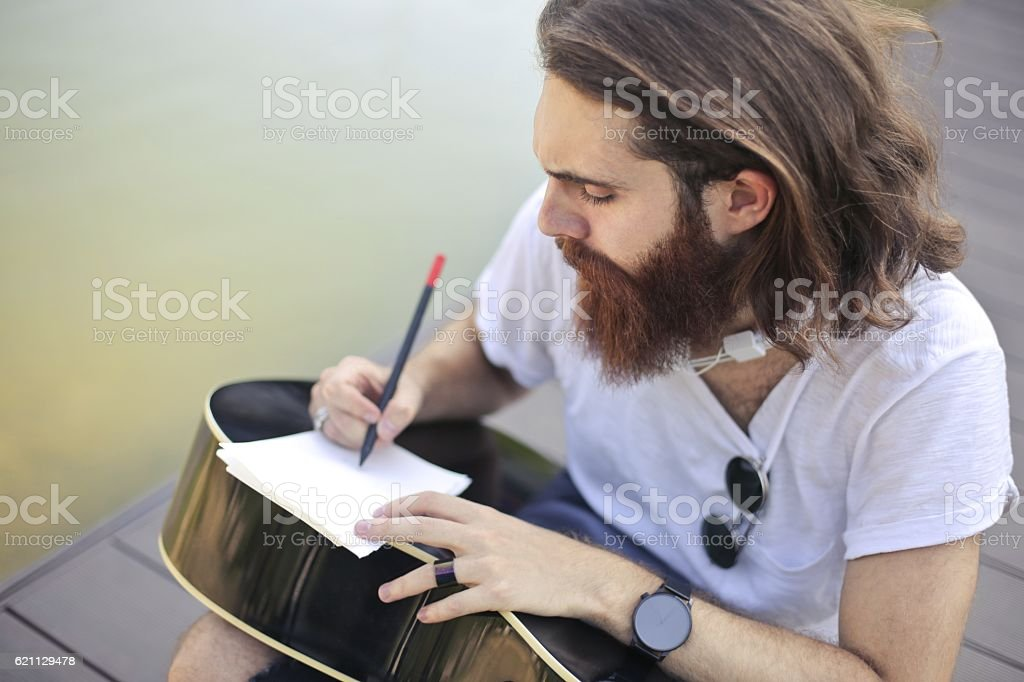 Writing on the guitar stock photo