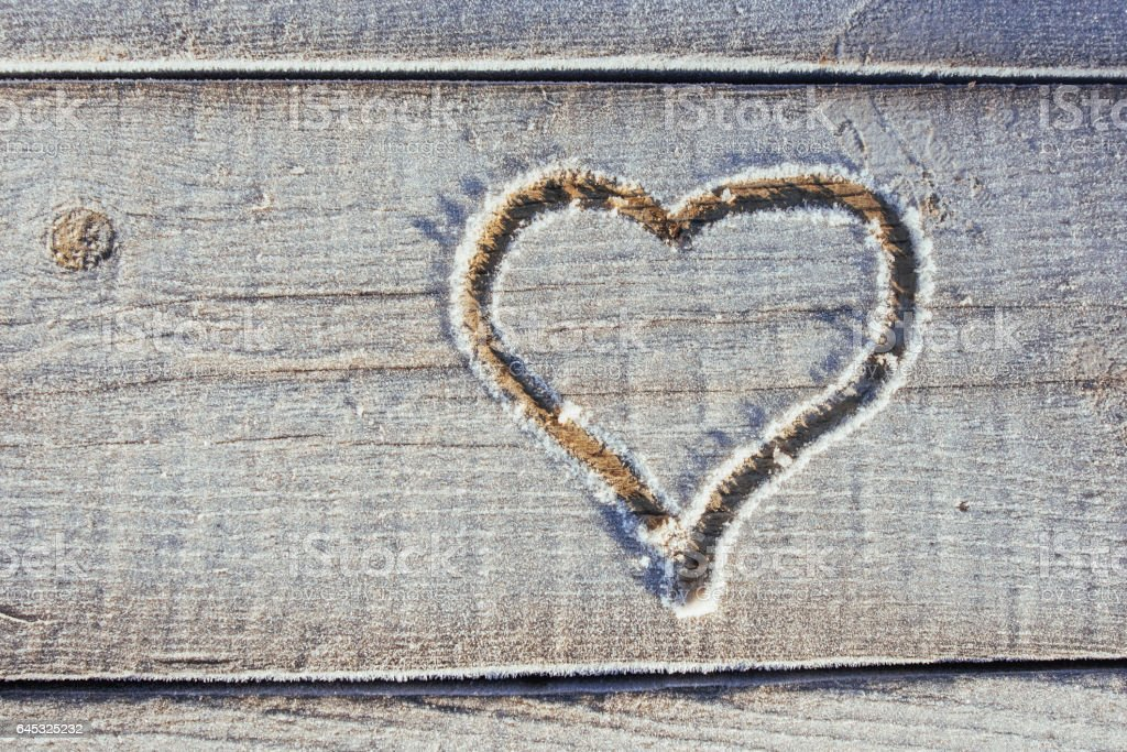 Writing on the snow. Wooden texture. stock photo